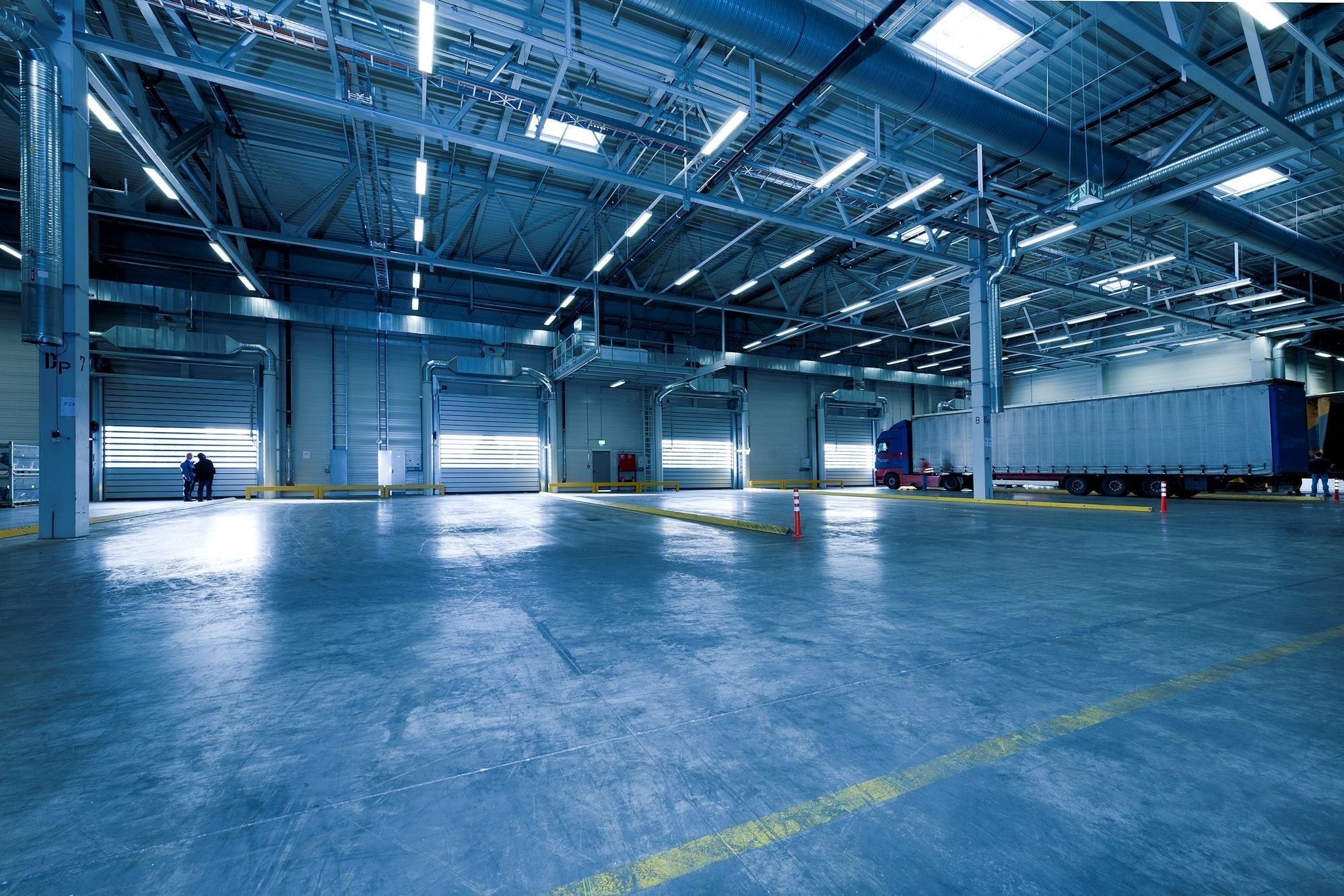 A blue warehouse which may be in need of an electric stacker lift.